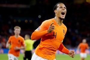 Netherlands' Virgil van Dijk celebrates after opening the scoring.