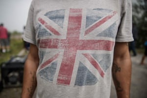 A migrant wears a t-shirt with the union flag