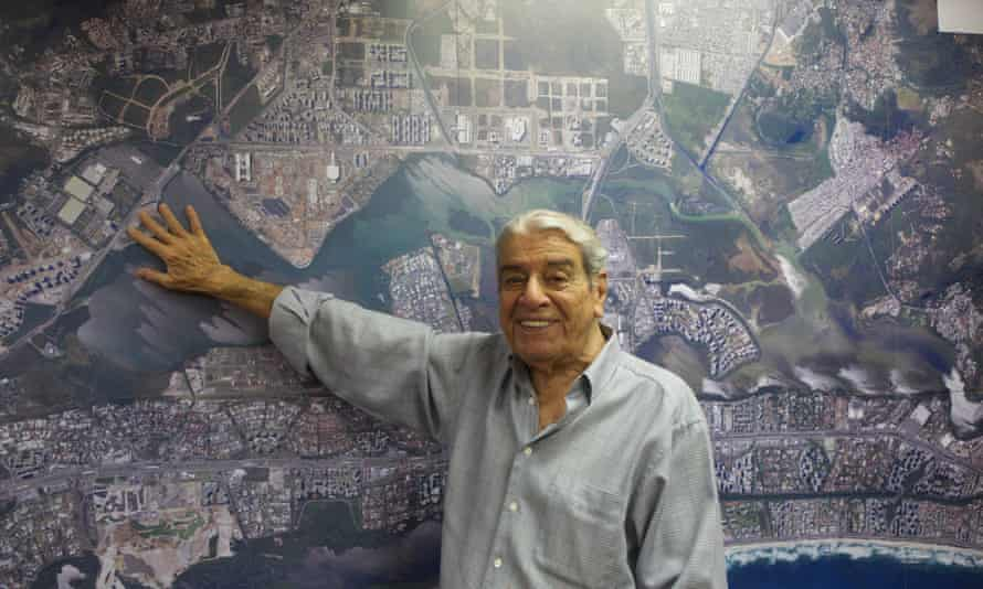 Carlos Carvalho with a map of the area around the Olympic Park in Rio.
