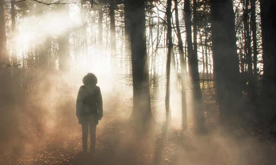 Silhouette of a woman in woods