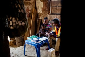 Saili Diadone consults with a mother at a new health site in Kisangani