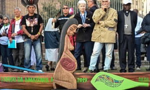 A wooden statuette of a pregnant woman during a procession of indigenous leaders at the Rome synod