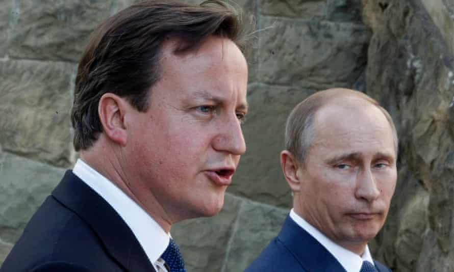 Vladimir Putin, right, and David Cameron speak to the media in the Black Sea resort of Sochi, Russia.