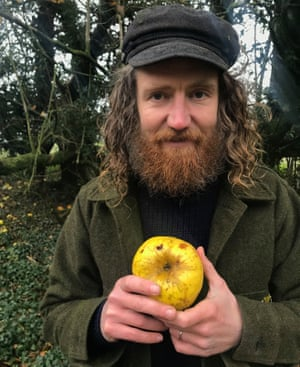 Archie Thomas holding a new variety of apple he discovered on a wooded trackway.