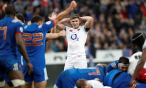 England's Owen Farrell looks dejected as France celebrate the Six Nations win in Paris in March.