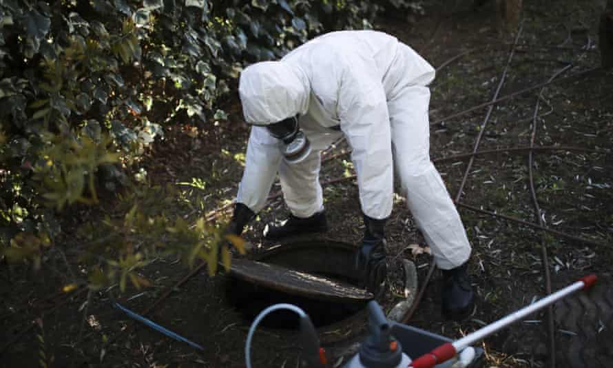 A firefighter in Marseille extracts samples of sewage water at a retirement home in Marseille, France.
