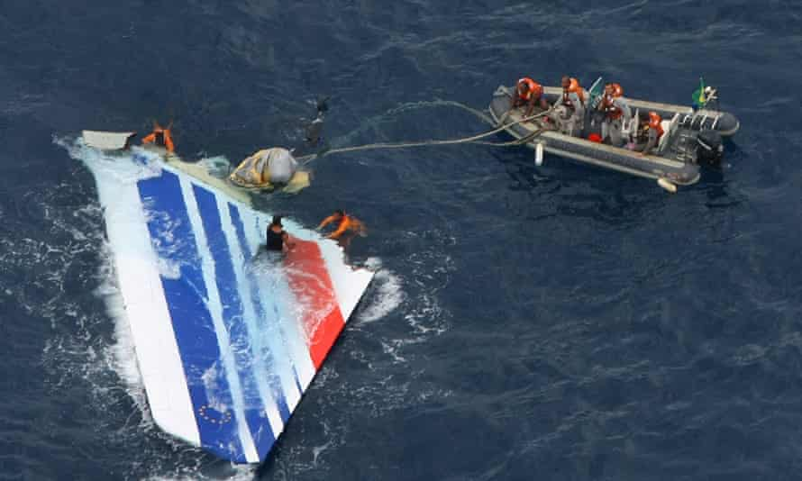 Dinghy approaches plane rudder in ocean