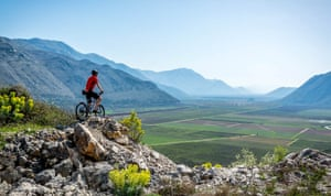 Cyclist on the Ciro trail, Balkans, looking over valley