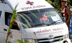 An ambulance believed to be carrying a rescued  schoolboy leaves from Tham Luang cave complex