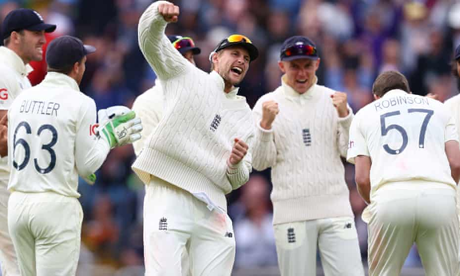 Joe Root and teammates celebrate the wicket of Rohit Sharma during the third Test between England and India at Headingley