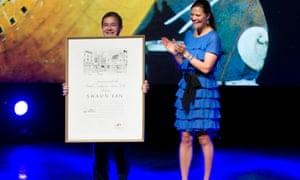Illustrator Shaun Tan receiving the Astrid Lindgren memorial award from Sweden's Princess Victoria in 2011.