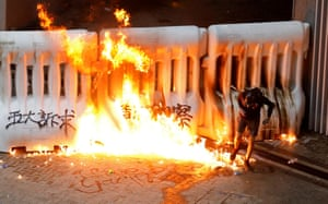 A demonstrator runs away from a burning barricade during a the protests , August 31, 2019.