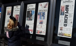 Newspaper front pages on display at the Newseum in Washington DC on 19 December 2019.