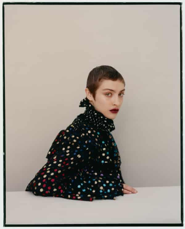 Abova wears top, £3,860, and cape, £2,305, by Saint Laurent.