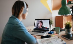 Young woman teleconferencing on laptop on conference call