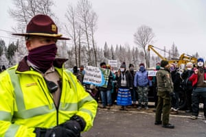 Environmental activists protest in front of the construction site for the Line 3 oil pipeline.