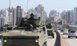 Brazilian marines patrol a street in Vitória, Espírito Santo, on Friday, where military police are on strike.