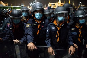 Thai Riot Police guard The Grand Palace as pro-democracy protesters march to deliver a letter to the King