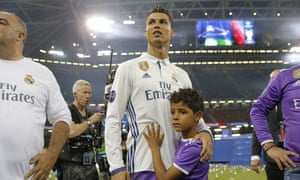 Real Madrid's Cristiano Ronaldo hugs his son, Cristiano Jr, after the UEFA Champions League Final victory over Juventus in Cardiff, Wales.