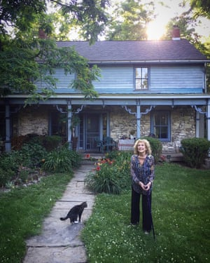 Carolee Schneemann and one of her cats outside her home in 2017.
