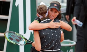 Johanna Konta hugs Marketa Vondrousova after defeat.
