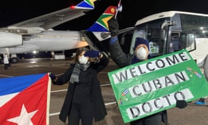 Cubans living in South Africa welcome a group of Cuban doctors