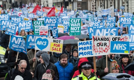 Thousands march through London to protest against underfunding and privatisation of the NHS