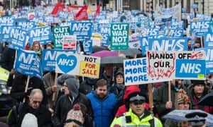Thousands of people take part in a march through central London towards Downing Street to protest against underfunding and privatisation of the NHS