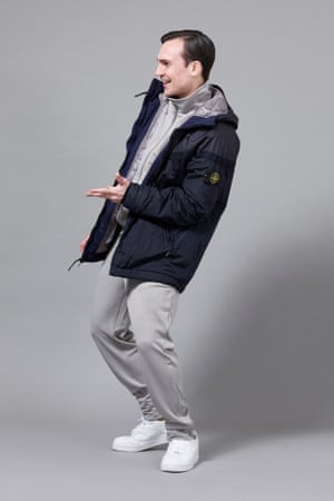 Henry Lloyd-Hughes wearing jacket by NikeLab x Stone Island, tracksuit by Adidas Spezial Beckembauer and trainers by Nike.