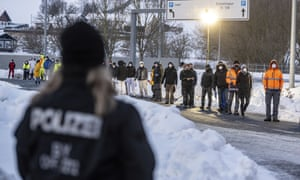 People wait in front of a coronavirus test station at the German-Czech Republic border in Furth im Wald, Germany.
