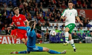 Republic of Ireland's Shaun Williams deftly dinks the ball over Wales keeper Wayne Hennessey to pull a goal back for the visitors.