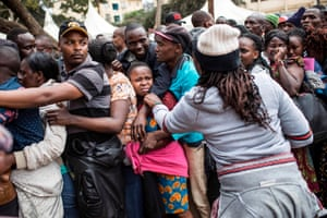 People queue to vote at a polling station at Kariokor Community Centre in Nairobi