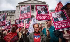 Bank of England workers, striking over pay, stage a protest outside the Bank in the City of London.
