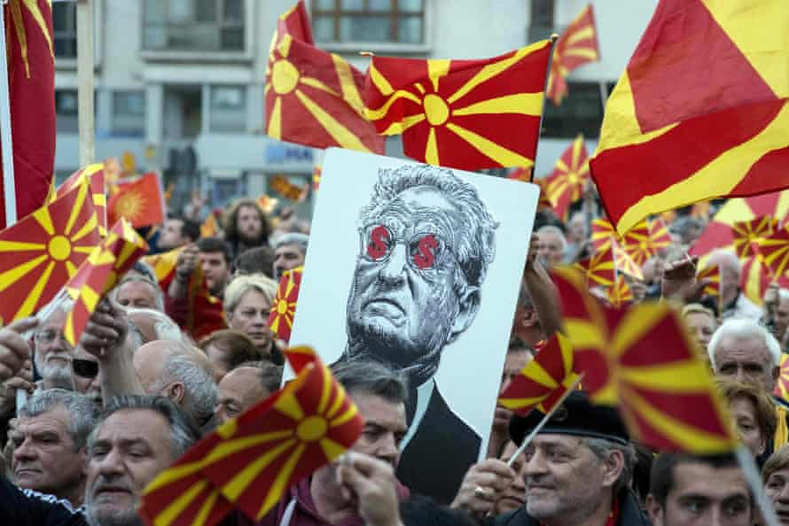 Protestors in Skopje, Macedonia, hold an antisemitic banner of Soros in 2017