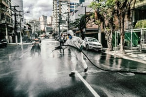 Street cleaners at work in the city of Niterói in south-east Brazil