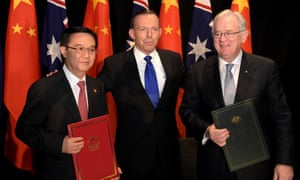 CANBERRA, AUSTRALIA - JUNE 17: (L-R) Chinese Minister of Commerce Dr Gao Hucheng, Australian Prime Minister Tony Abbott and Australian Minister for Trade Andrew Robb pose for a photograph after signing the Free Trade Agreement (FTA) between the two countries on June 17, 2015 in Canberra, Australia. Hucheng is in Australia to formalise the free trade agreement between Australia and China. (Photo by Lukas Coch - Pool/Getty Images)