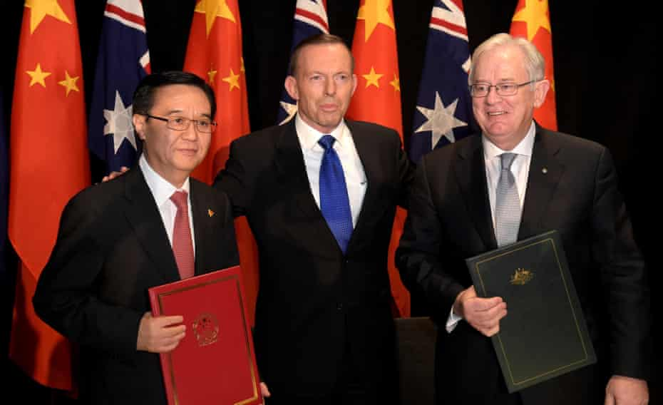 Chinese Minister of Commerce Dr Gao Hucheng, Australian Prime Minister Tony Abbott and Australian Minister for Trade Andrew Robb pose for a photograph after signing the Free Trade Agreement between the two countries in Canberra in June. Robb clashed with broadcaster Alan Jones, accusing him of running a 'racist' scare campaign about foreign ownership of Australian farmland.