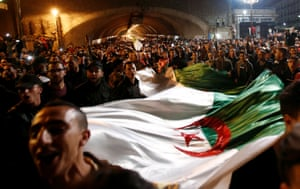 Algiers, AlgeriaPeople carry a national flag as they celebrate on the streets after Algeria's President Abdelaziz Bouteflika has submitted his resignation
