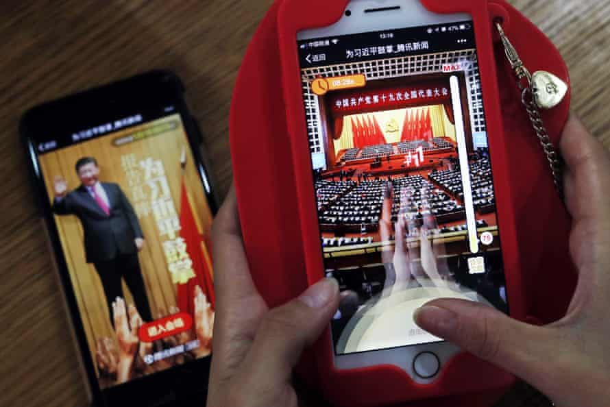 A student in Beijing plays a popular smartphone game called A Great Speech, Clap for Xi Jinping.