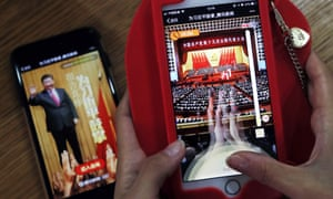 A woman plays a Tencent smartphone game called A Great Speech, Clap for Xi Jinping in Beijing in 2017.
