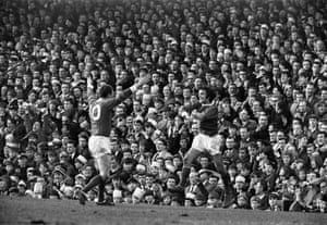 Best celebrates after scoring the third goal in an FA Cup fifth-round win over Wolves at Molineux with team-mate David Herd in March 1966