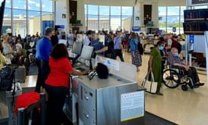 Passengers wait inside a terminal at Washington Reagan national airport.