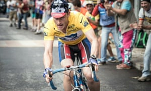 Still from the film The Program showing actor Ben Foster riding a bike
