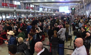Huge queues at Sydney's domestic terminal on Monday as passengers are subjected to increased security following a number of terrorism raids over the weekend. (