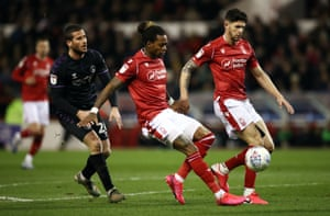 Charlton Athletic's Tomer Hemed tracks Forest's Gaetan Bong and Tobias Figueiredo but it is still goalless at the City Ground.