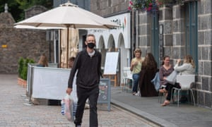 Residents walk in central in Aberdeen, eastern Scotland on August 5, 2020 following the announcement that a local lockdown has been imposed on the city after a spike in the number of cases of Covid-19. Credit: Michal Wachucik/AFP via Getty Images)