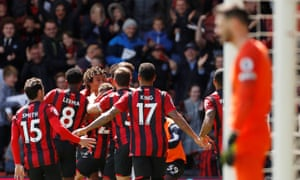 Nathan Aké celebrates his late winner for Bournemouth against nine-man Spurs.