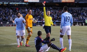 New England's José Gonçalves is sent off by Mark Geiger for his foul on Khiry Shelton of New York City.