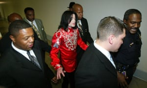 Jackson with his personal security in 2004