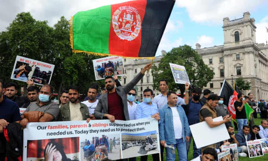 Protesters in Parliament Square, London, call on the UK government to protect Afghan people